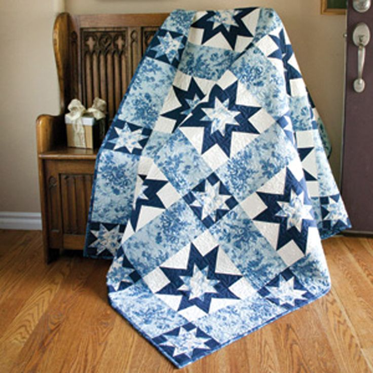 Two variations of the classic Sawtooth Star Block twinkle and shine in this frosty tribute to the winter season. Ice Garden is simple to piece and a fabulous quilt pattern to show off favorite blue and white fabrics.