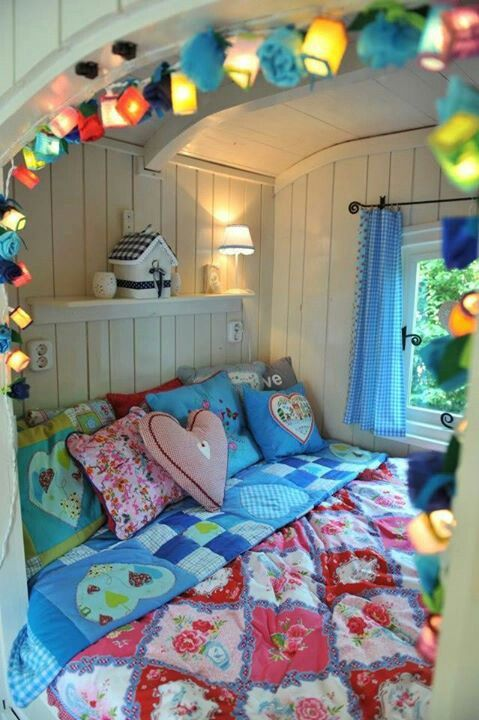 Gypsy caravan <3 the bed nook with lights and the bright colours against the white wood