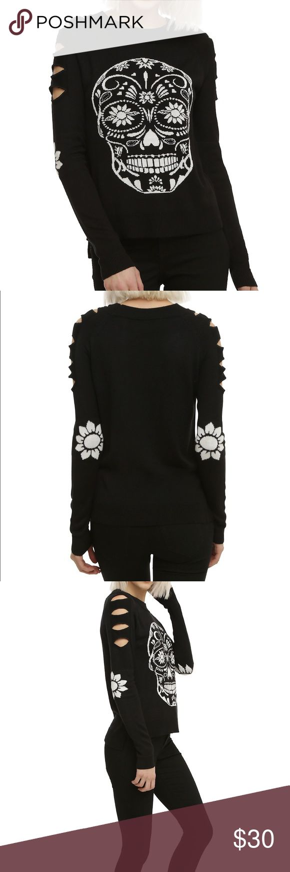 Sugar skull sweater Black pullover sweater with a white sugar skull graphic on the front, flower graphic on elbows and slash detail on the shoulders. Brand new with tags. Hot Topic Sweaters
