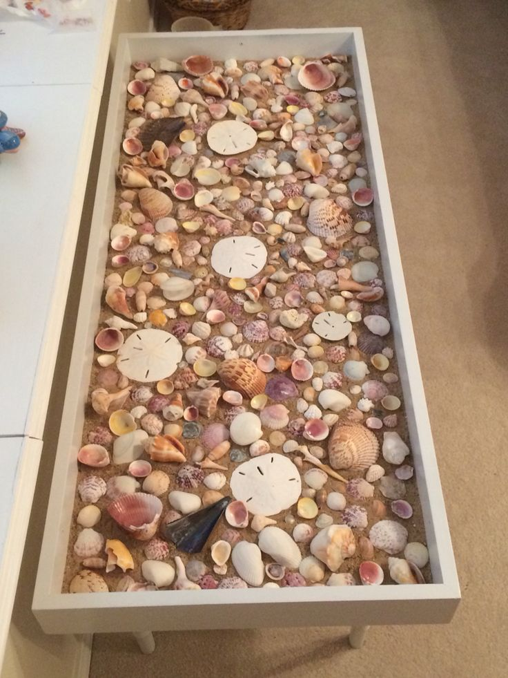 Seashell coffee table - Ugly, old shadow box table that I painted white, added sand, and added seashells I collected in Sanibel, FL (glass not placed here).....Inspired by: https://www.primeriti.es/blog/decoideas/ideas-para-decorar-con-conchas-marinas/