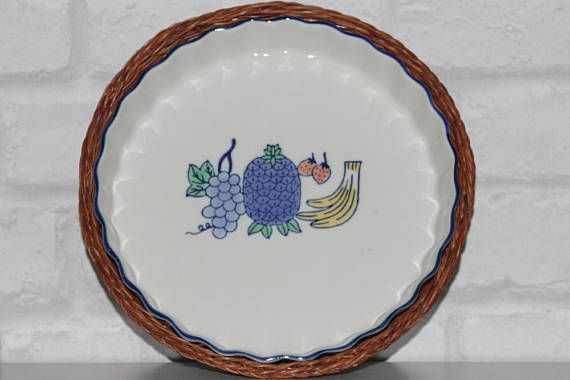 Flan dish in basket with blue pineapple and grapes