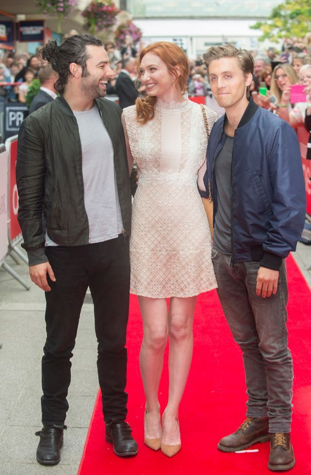 Aidan Turner, Eleanor Tomlinson and Jack Farthing look the part on the red…