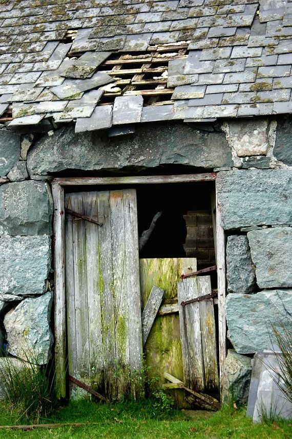 Stone barn w/old door.