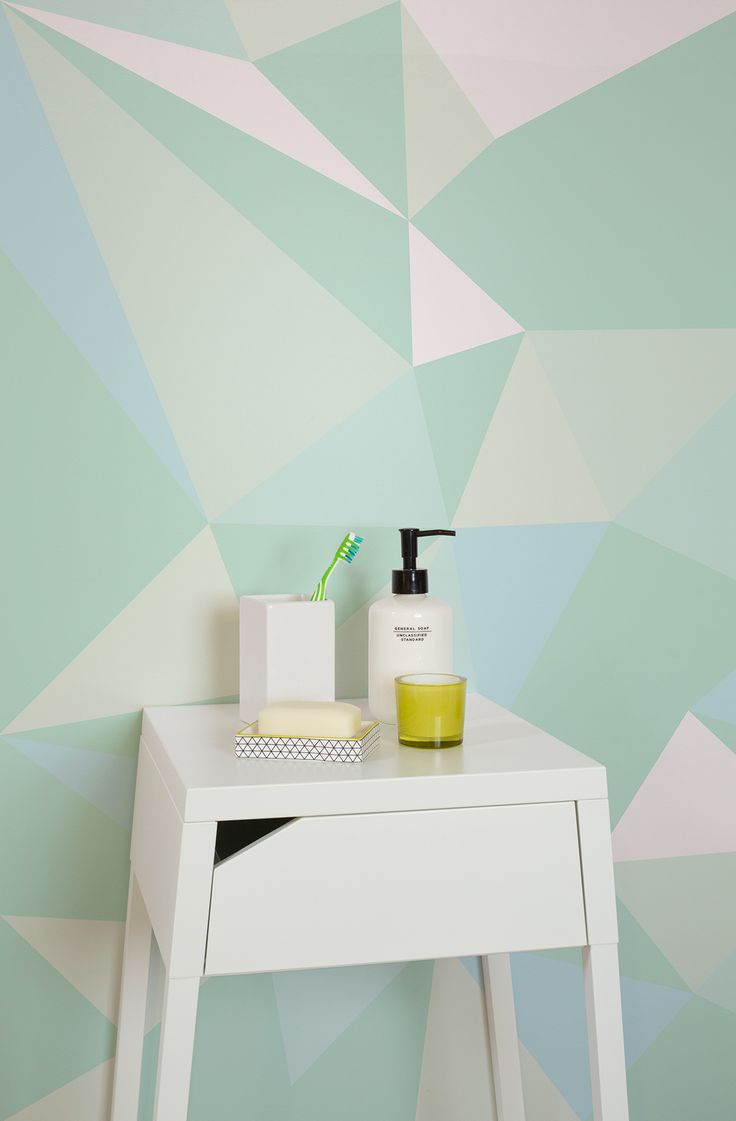 Bathroom spaces don't have to be boring. Liven up your walls with this geometric wallpaper. Beautiful shades of pastel green come together to create a geometric wonder for your walls.