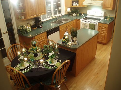 Dazzling Kitchen Island With Dining Table Attached Using Stainless Steel Lantern Candle Holder