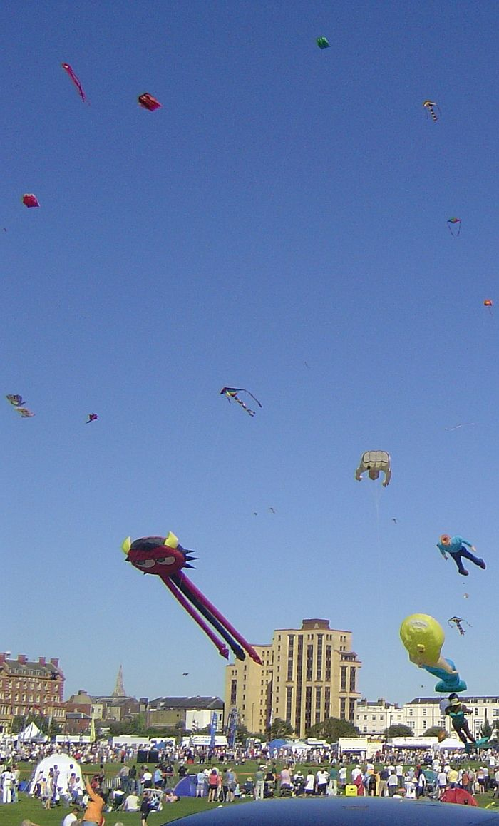 """A big kite festival at an urban venue. So many kites, so many people... T.P. (my-best-kite.com) """"Kite Festival Picture"""" Cropped from a photo by Prozak is gone on Flickr (cc)"""