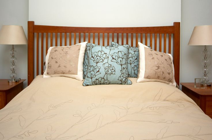 Warm bedroom with embroidered silks and beautiful textured cushions.