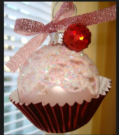Clear bulb w pink lace or fabric w glitter in and outside. Hot glue a small red ball to top side and add a cupcake paper glued to the bottom