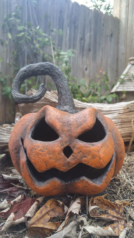 This is Frank! A Scary primitive Halloween Jack o Lantern, made of Paper Mache. He's a unique piece of Folk Art and one of a kind!