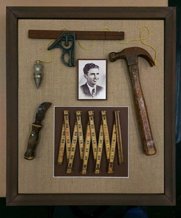 A striking collection of vintage carpentry tools from the 1940s with burlap backing in a rustic wooden shadowbox frame. The shadowbox honors our client's grandfather who was a carpenter by trade. A wonderful way to display and preserve cherished keepsakes.
