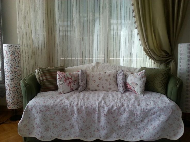Shabby chic sofa .... I dropped a floral quilt 60 dollars better than reupholstery which cost far more. I made the pillows with left over floral cloth.