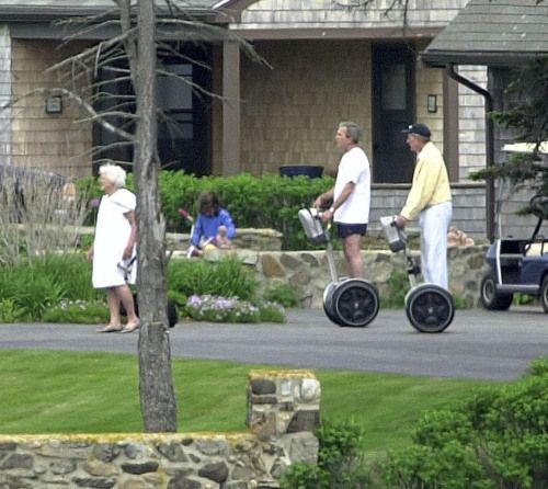 George W Bush and his father chase Barbara Bush on segways