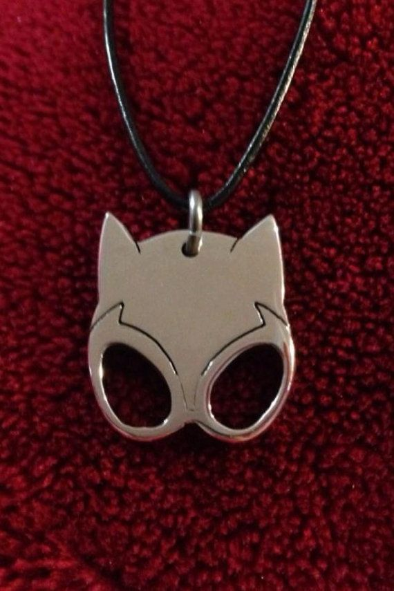 Catwoman Mask Aluminum and Leather Necklace All Handmade. Catwoman status as hero or villain is ambiguous; she has her own moral code and has