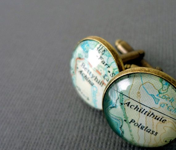 A pair of personalised map cufflinks created using real pages of maps, each one showing a placename. A wonderful bronze anniversary gift for your