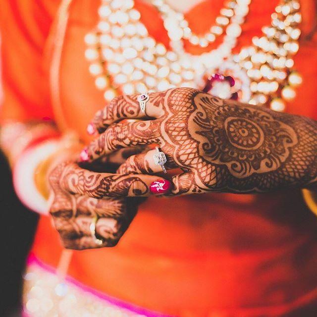 Isn't this bride Rubi's manicure a stunner?  Photo Courtesy- @thevivahproduction  #bridalportraits #details #mehendi #manicure #necklace #diamonds #floraldesign #gettingreadymoments #behindthescenes #bling #jewellery #bridaljewellery #indianbride #makeupartists #wedding #indianweddings #weddinglook #bridallook #weddingsutra #lehenga #bridalfashion #traditional #bridalmakeup #makeupartist #bridalmanicure #nailart