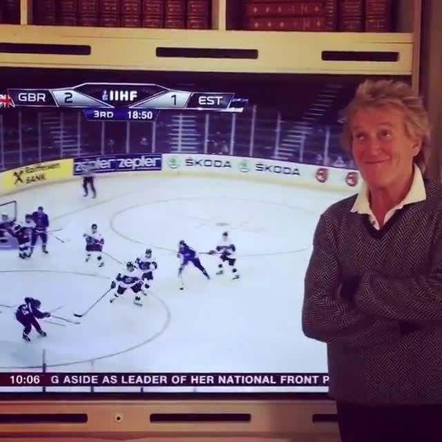 Rod Stewart shows his pleasure at his son scoring his first hockey goal for Great Britain.
