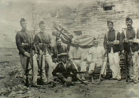 Seven members of the Royal Marine Light Infantry and one of the Naval Brigade during the Boxer Rebellion, Peking, 1900.