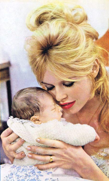 brigitteritajayne:   Brigitte holding her son, Nicolas, 1960 * source