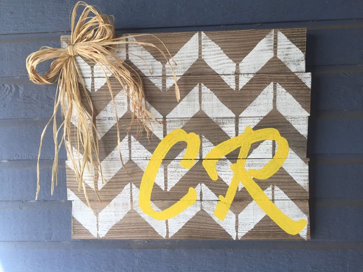 A personal favorite from my Etsy shop https://www.etsy.com/listing/266241167/personalized-chevron-initial-sign
