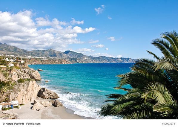 Nerja Beach near Malaga, Spain - Nerja is a tourist destination on the Costa del Sol. The town is built on a hillside and boasts wonderful beaches where you can enjoy water sports, taste delicious food or just relax in the sun.