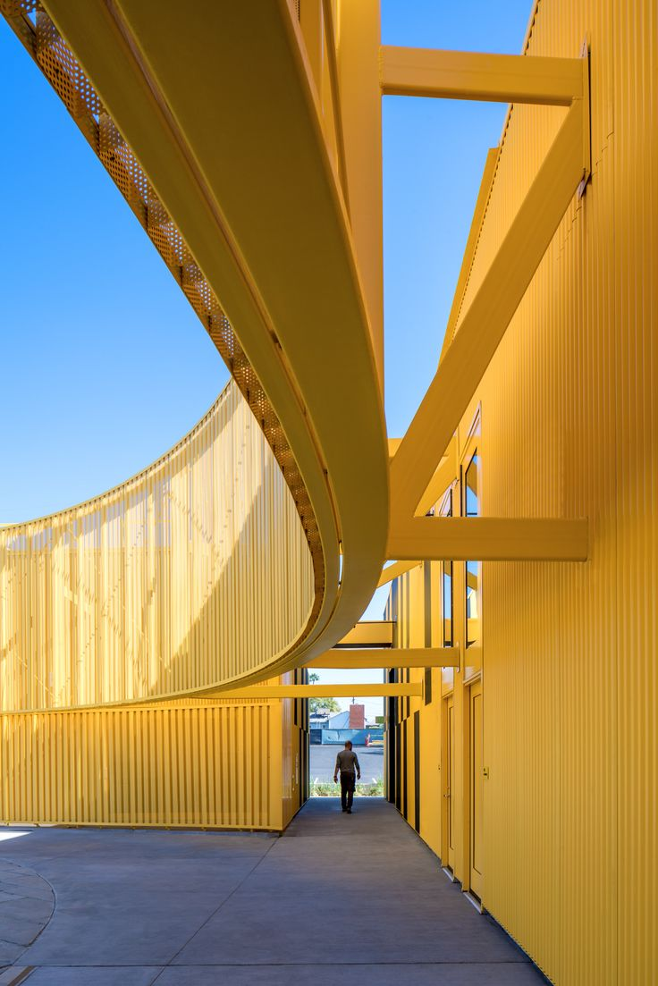 Animo south los angeles high school is wrapped in anodised - Interior design school los angeles ...