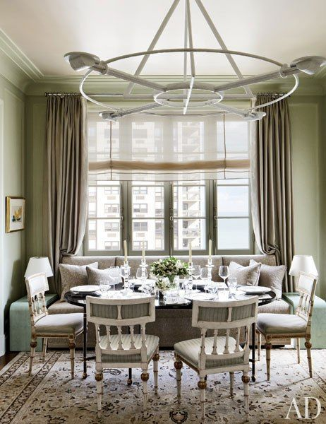 The pale green dining room of a Chicago penthouse designed by Michael S. Smith