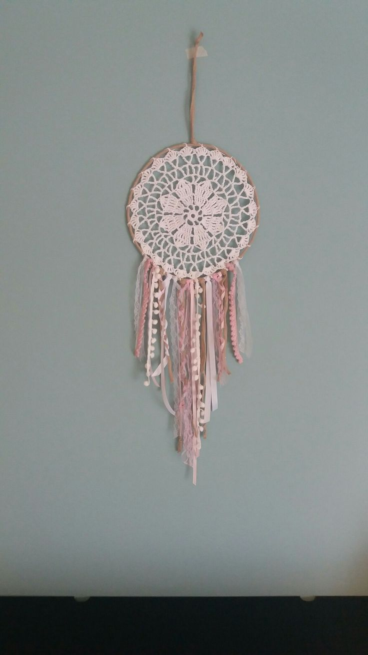 Handmade crochet round dreamcatcher with white and pink boho ribbons and pom pom