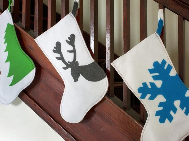 HGTV- Felt Silhouettes  Make it modern this holiday season with graphic felt silhouette stockings. Decide on a holiday shape that's easy to identify, trace it directly onto colored felt with a marker, cut it out with scissors and attach to a felt stocking body with fabric glue.