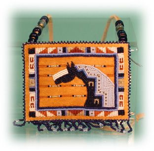 beaded pouch by Jackie Bread - I love the geometric linear symbol styling!