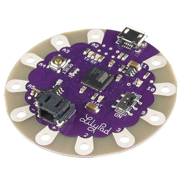 LilyPad Arduino USB - ATmega32U4 Board.  This is the version I need.  No external programmer needed, just add battery connector and sensors. $24.95.
