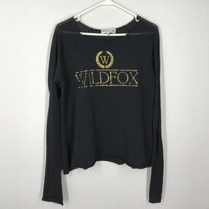 I just added this to my closet on Poshmark: Wildfox black and gold long sleeve top size small. Price: $16 Size: S