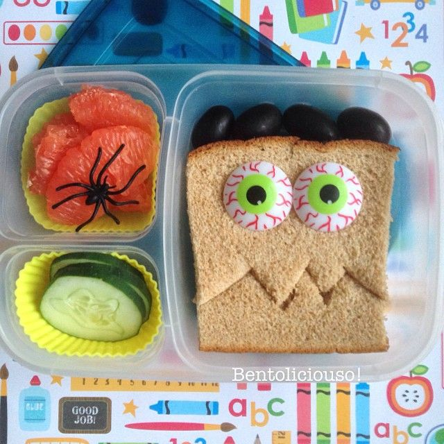 Green-Eyed Monster turkey sandwich, spidery grapefruit, ghostly cucumber slices, and black grapes for lunch - via bentoliciouso - Instagram