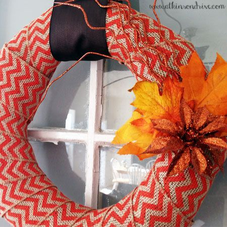Make this colorful Fall wreath using a roll of chevron burlap ribbon and some faux Fall foliage! #fall #decor
