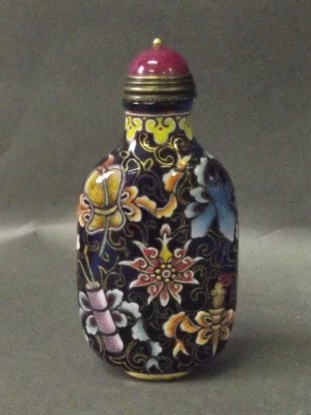 A blue glass snuff bottle painted with coloured flowers to sides