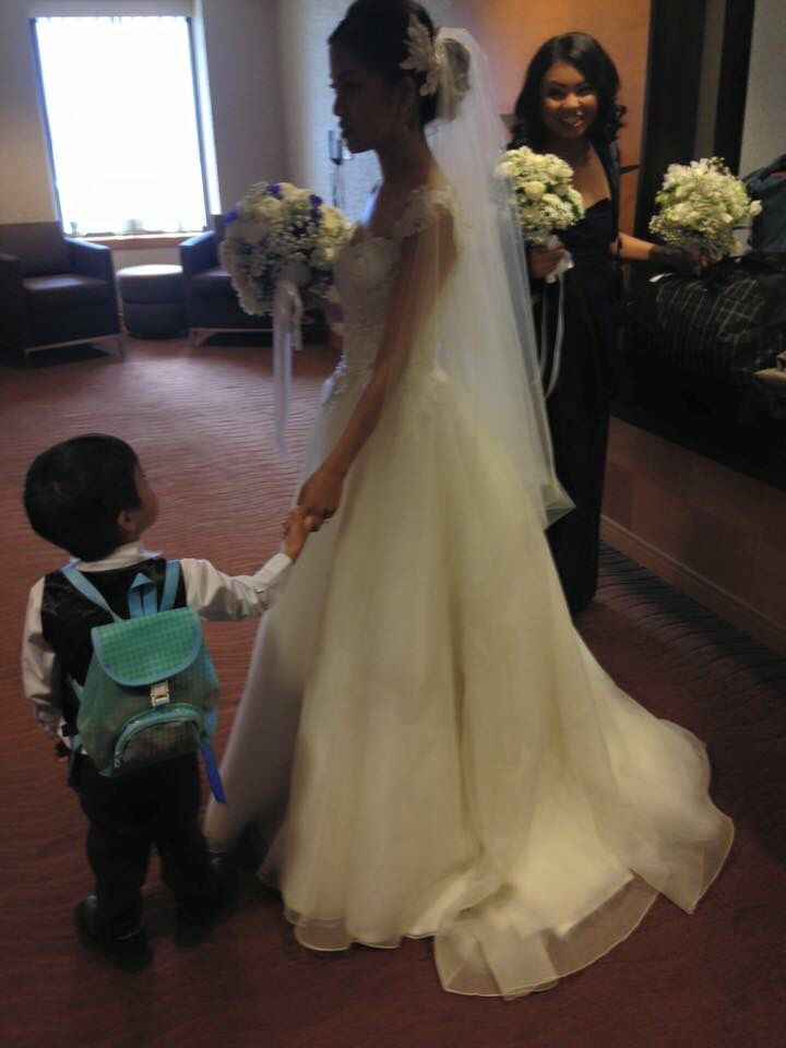Our gorgeous Bride, Yumi ❤️ In De Lanquez Bridal gown.