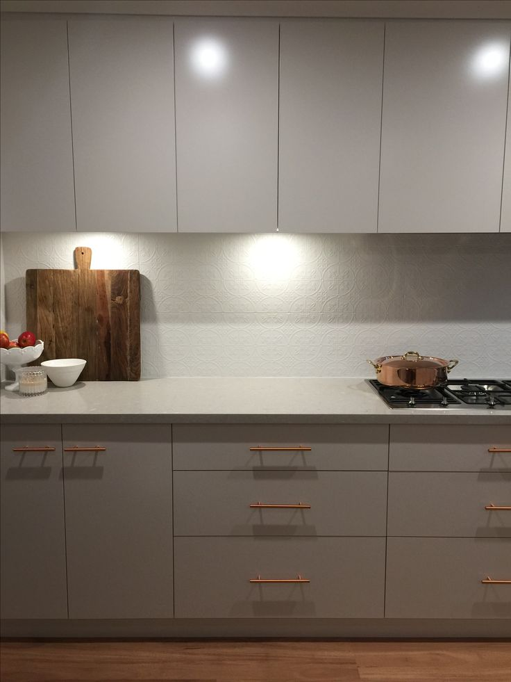 Our new kitchen! Created by KitchenKraft (Sydney Australia).... Clamshell Caesarstone, cabinetry in Dulux 'limed white quarter', splashback tiles from Southern Cross Ceramics 'infinity Brighton', copper T-bar drawer pulls/handles from Forge Hardware Studio via Etsy
