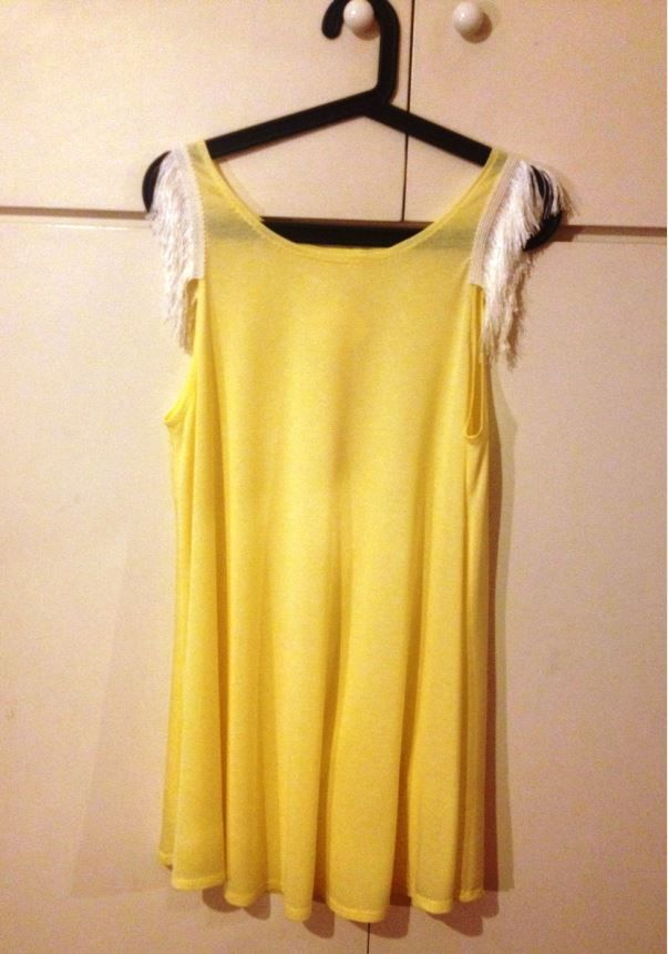 Yellow is the new black! With a white fringe detail!