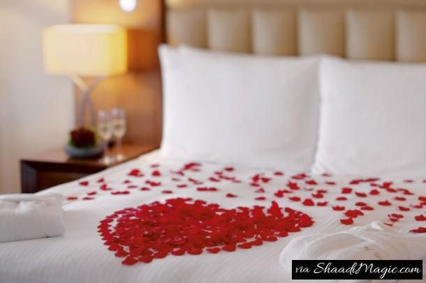 First and foremost Idea: Flowers and hearts  Flowers set any occasion right with its delicacy and fragrance. How can one miss it out during first night décor? You can keep it simple by just sprinkling rose petals on the bed with the heart made out or you can fully decorate it with corners or sides of the bed decorated with flower garlands.