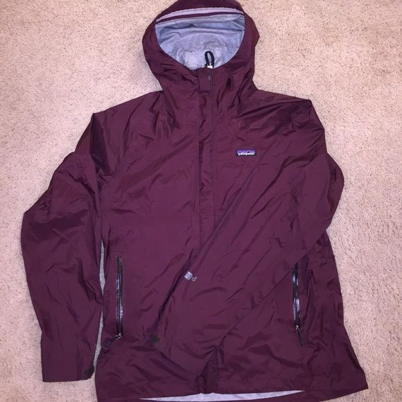 Patagonia rain jacket Dark purple women's Patagonia rain jacket. Small area of some discoloration (in photos) but other than that in excellent condition. Zips up front, with Velcro over the zipper. Velcro cuffs so you can tighten. Runs large Patagonia Jackets & Coats Utility Jackets