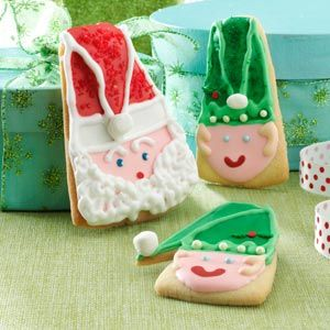 Santa and Elf Christmas Cookies Recipe -The kids will be jumping for joy when you bring out a cookie plate filled with Santas and his helper elves. These whimsical treats will be a hit with adults, too. The butter cookies are easy to shape and a delight to decorate. —Taste of Home Test Kitchen