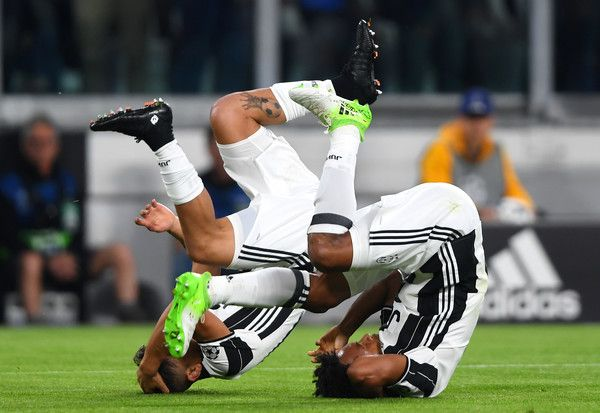 Paulo Dybala of Juventus celebrates with Juan Cuadrado after scoring the opening goal during the UEFA Champions League Quarter Final first leg match between Juventus and FC Barcelona at Juventus Stadium on April 11, 2017 in Turin, Italy.