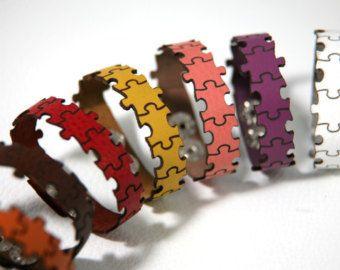 Laser cut leather bracelet cuff with sun design.