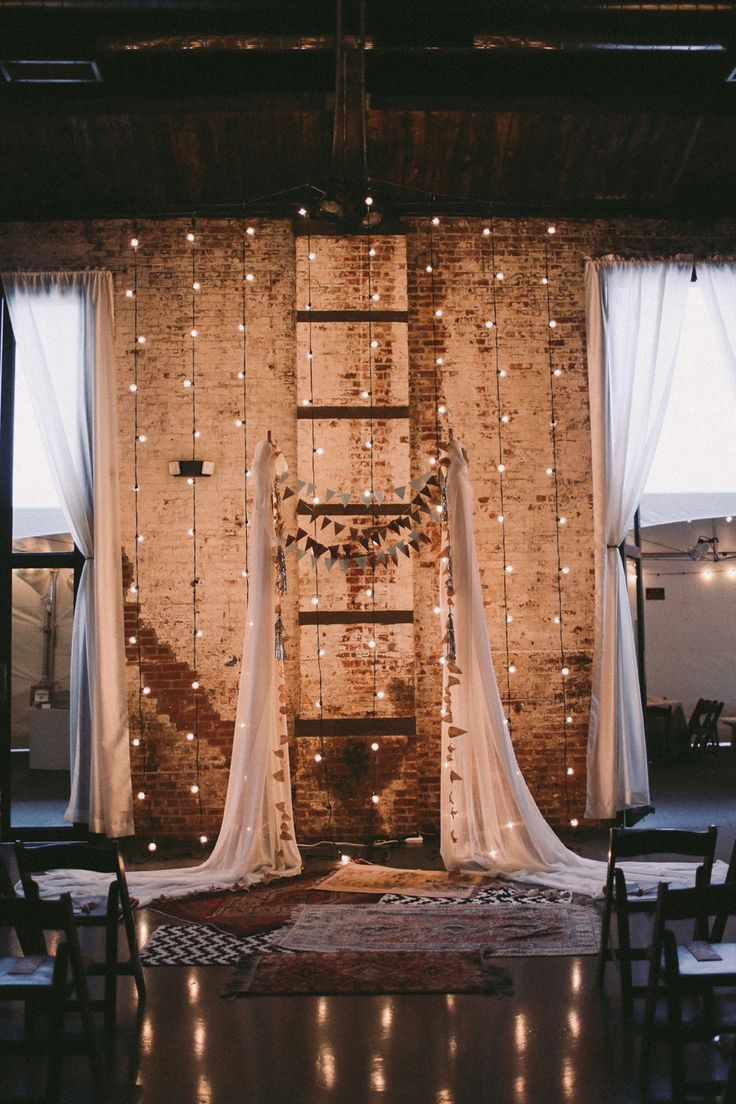 This Lighting and Backdrop are Magical!! See the wedding here:   http://www.StyleMePretty.com/2014/04/15/whimsical-brooklyn-wedding/ SMP - FeatherAndTwinePhotography.com