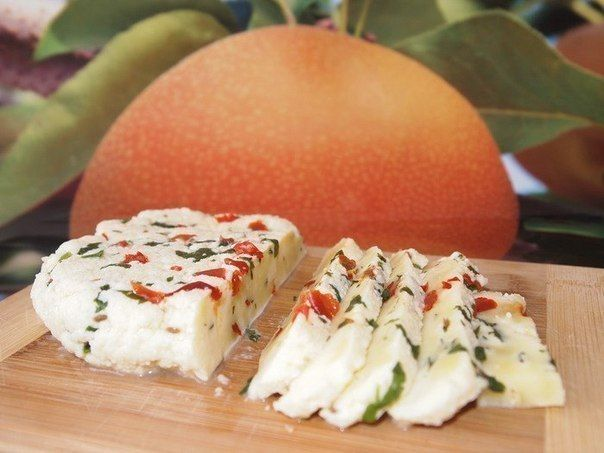 Homemade cheese with herbs and cumin
