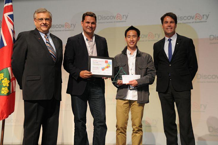 Riley Tsang receiving his award for Simplistic Lawn Care