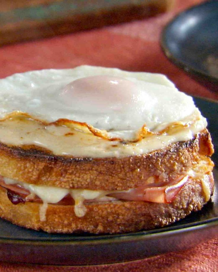 Croque Madame. This classic ham sandwich from France is drizzled with bechamel sauce and topped with fried eggs.