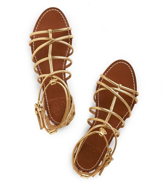 new flat gold sandal from Tory Burch. Perfect for Toga pub crawl?