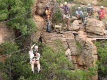 Magaliesberg Canopy Tours - Only 1,5 hours from Johannesburg and Pretoria at the Sparkling Waters Hotel and Spa.  Experience the 2 400 million years old Magaliesberg Mountains on a unique 2,5-hour canopy tour through the Ysterhout Kloof. The Magaliesberg Canopy consists of 11 platforms built high within the rock faces of the kloof, joined by ten slides up to 140 m long and 30 m above the stream.
