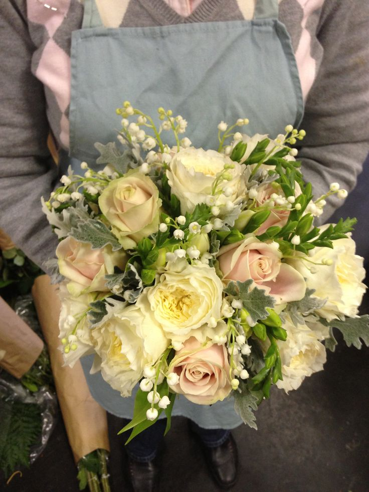 A mix of David Austin roses sweet avalanche roses, fressia, and lily of the valley. an incredibly fragrant  bouquet