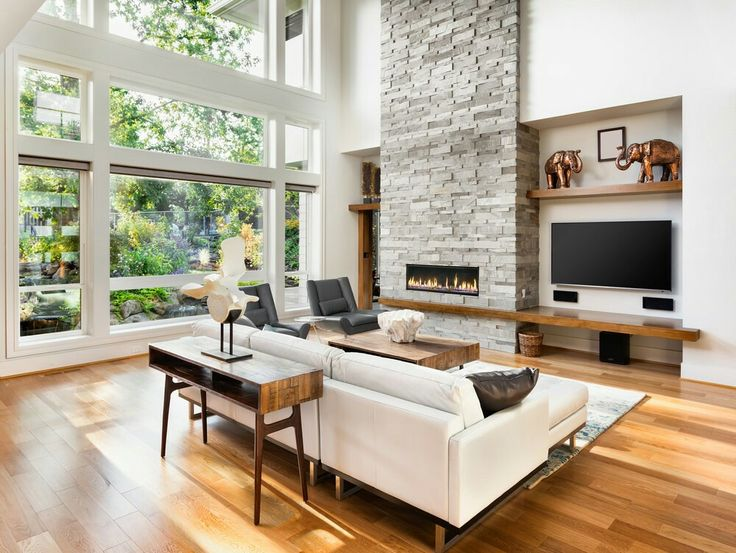 there is a simple yet classy offwhite sofa resting in front of a wide small living